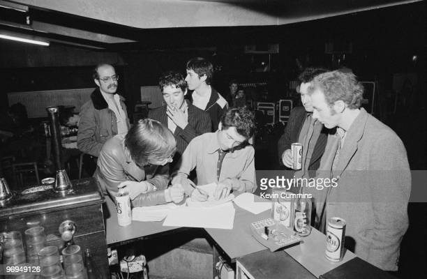 Singer Pete Shelley of English punk band the Buzzcocks signs a contract at the Electric Circus in Manchester England on August 16 1977
