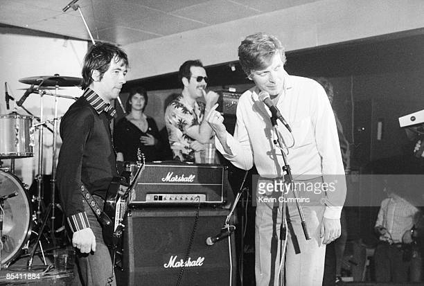 Singer Pete Shelley of English punk band The Buzzcocks with cofounder of Factory Records and presenter of TV music show 'So It Goes' Tony Wilson at...