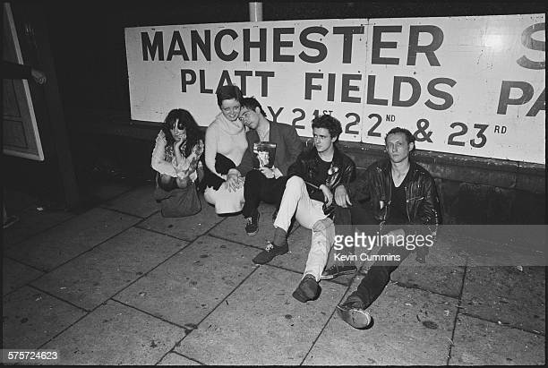 Singer Pete Shelley of English punk band the Buzzcocks with punk friends outside the Ranch Club in Manchester 22nd July 1977 On the right are bassist...