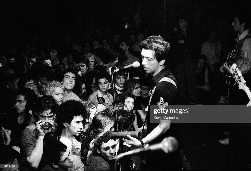 Singer Pete Shelley performing with English punk band The Buzzcocks at the Marquee Club, London, 4th August 1977.