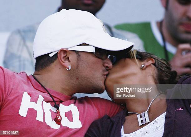 Singer Peter Andre kisses wife model Katie Price also known as Jordan as they watch the Sport Relief cricket match between The Sport Relief Red Socks...