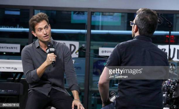Singer Peter Cincotti and moderator Matt Forte attend Build to perform Long Way From Home at Build Studio on October 11 2017 in New York City