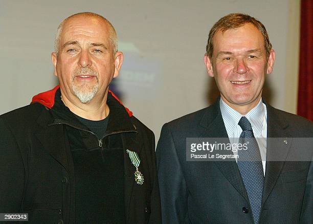 Singer Peter Gabriel poses with French Minister of culture Jeanjacques Aillagon during the 38th Midem International Music Market on January 26 2004...