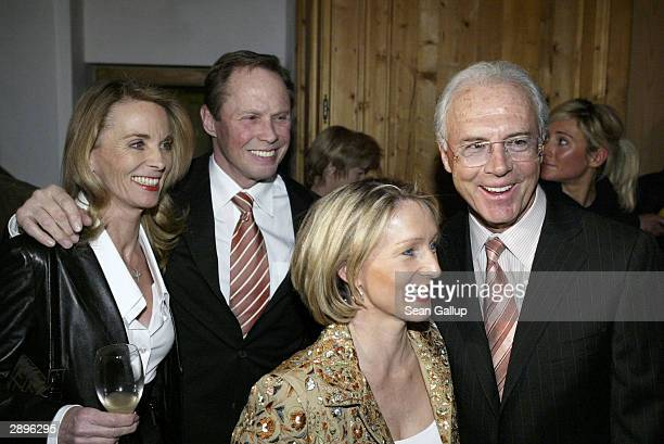 Singer Peter Kraus his wife Ingrid Heidrun Burmester and FC Bayern Muenchen president Franz Beckenbauer attend the Audi Evening at Hotel Tenne during...