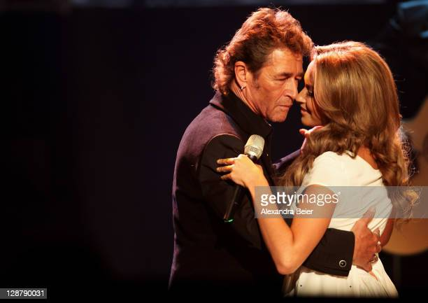 Singer Peter Maffay and Mandy Capristo perform during the 'Wetten dass' Show at the Messehalle on October 8 2011 in Nuremberg Germany