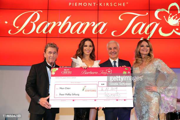 Singer Peter Maffay Kate Beckinsale Carlo Vassallo Director Ferrero Germany and Frauke Ludowig with check during the 10th Mon Cheri Barbara Tag at...