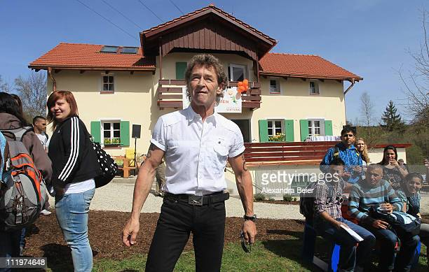 Singer Peter Maffay poses in front of the new 'Tabaluga house Jaegersbrunn' by his Tabaluga children foundation on April 11 2011 in Munich Germany...