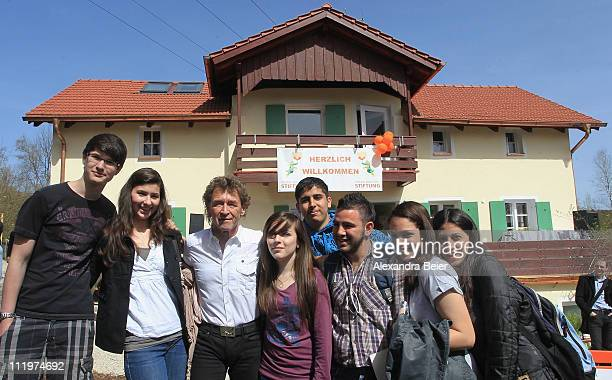 Singer Peter Maffay poses with youths in front of the new 'Tabaluga house Jaegersbrunn' by his Tabaluga children foundation during the opening...
