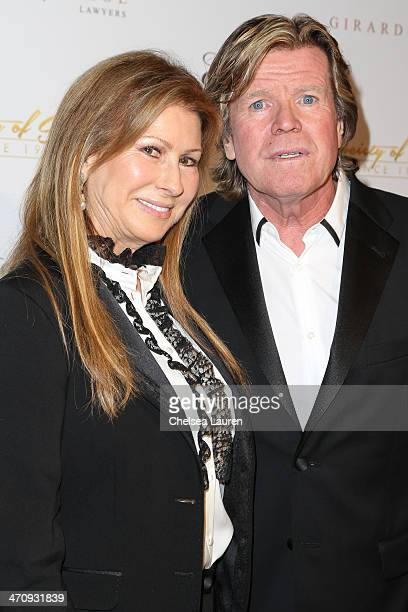 Singer Peter Noone and wife Mireille Strasser Noone arrive at the 21st ELLA Awards at The Beverly Hilton Hotel on February 20 2014 in Beverly Hills...
