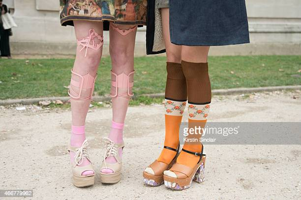Singer Petite Meller wears Miu Miu shoes With a guest wearing sandals on day 8 of Paris Collections Women on March 10 2015 in Paris France