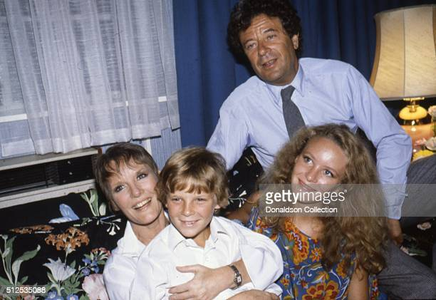 Singer Petula Clark with her son Patrick Wolff, husband Claude Wolff and daughter Kate Wolff perform onstage in 1981.