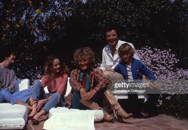 Singer Petula Clark with her son Patrick Wolff, husband Claude Wolff and daughter Kate Wolff perform onstage in 1985.