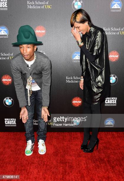 Singer Pharrell Williams and Helen Lasichanh arrive at the 2nd Annual Rebels With A Cause Gala at Paramount Studios on March 20 2014 in Hollywood...