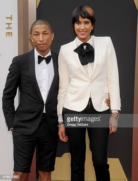 Singer Pharrell Williams and Helen Lasichanh arrive at the 86th Annual Academy Awards at Hollywood Highland Center on March 2 2014 in Hollywood...