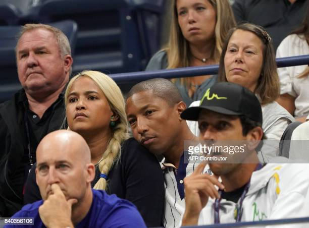 Singer Pharrell Williams and his wife Helen Lasichanh watch the match between Darian King of the US and Alexander Zverev of Germany at the 2017 US...