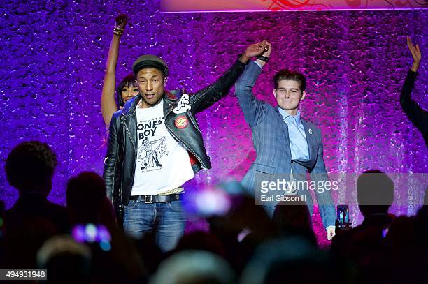 Singer Pharrell Williams and Honoree Cameron Burnett share a moment at the 2015 UCLA Neurosurgery Visionary Ball at the Beverly Wilshire Four Seasons...