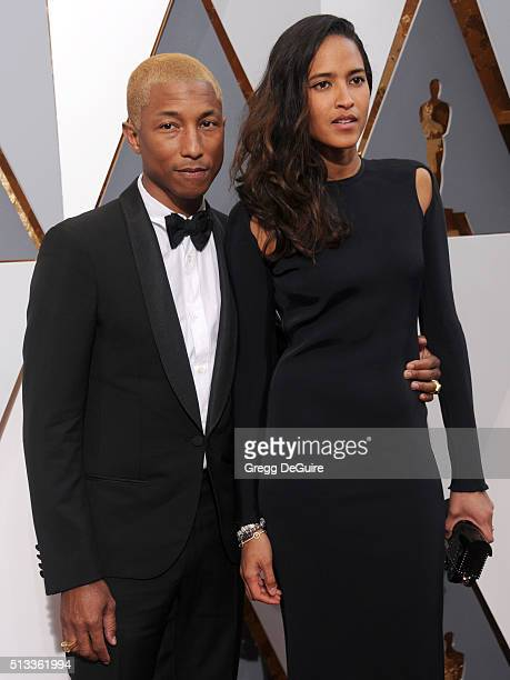 Singer Pharrell Williams and model Helen Lasichanh arrive at the 88th Annual Academy Awards at Hollywood Highland Center on February 28 2016 in...