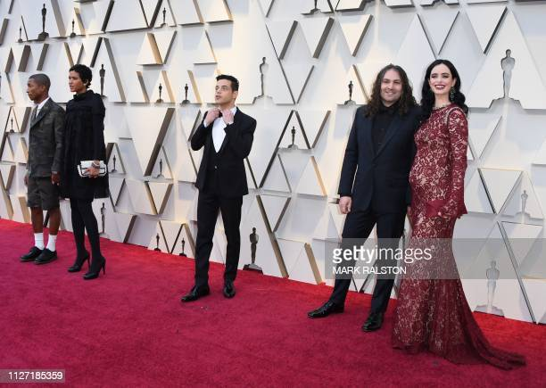 US Singer Pharrell Williams his wife Helen Lasichanh actor Rami Malek actress Krysten Ritter and Adam Granduciel arrive for the 91st Annual Academy...