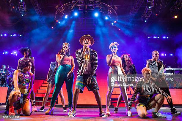 Singer Pharrell Williams performs at the Coachella valley music and arts festival at The Empire Polo Club on April 19, 2014 in Indio, California.