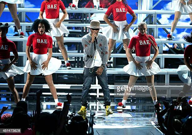 Singer Pharrell Williams performs onstage during the BET AWARDS '14 at Nokia Theatre LA LIVE on June 29 2014 in Los Angeles California