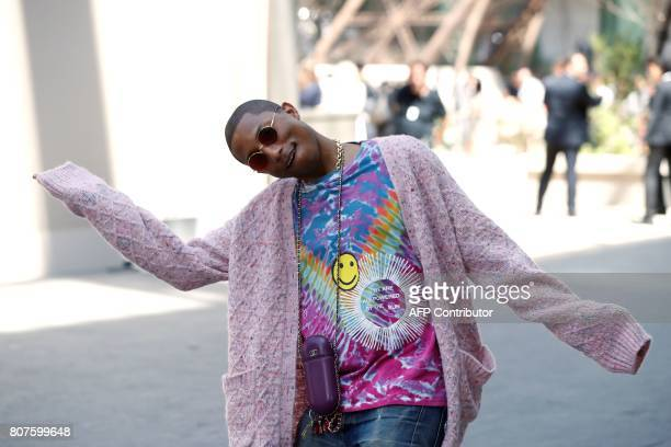 US singer Pharrell Williams poses during the photocall before Chanel 20172018 fall/winter Haute Couture collection show in Paris on July 4 2017 / AFP...