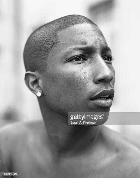 Singer Pharrell Williams poses for a portrait session in 2003 for One World Magazine
