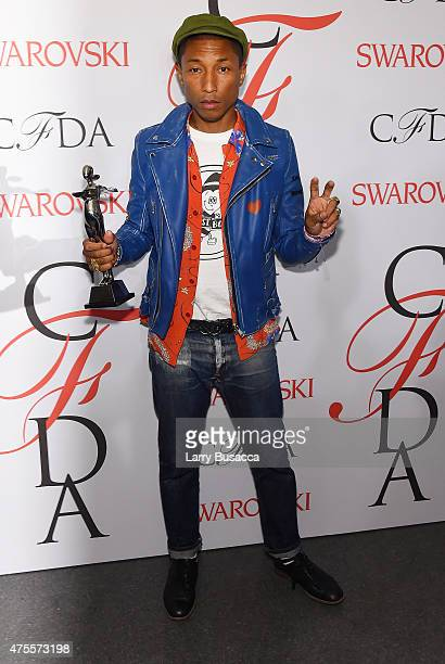 Singer Pharrell Williams poses on the winners walk at the 2015 CFDA Fashion Awards at Alice Tully Hall at Lincoln Center on June 1 2015 in New York...