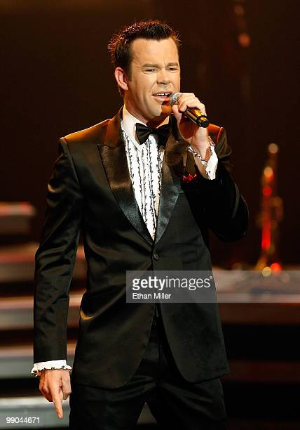 """Singer Phil Burton of Human Nature performs after announcing a two-year extension of the Australian vocal group's headline show, """"Smokey Robinson..."""