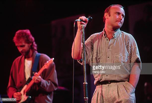 Singer Phil Collins and guitarist Mike Rutherford of Genesis perform together at the Atlantic Records 40th Anniversary Party in Madison Square Gardens