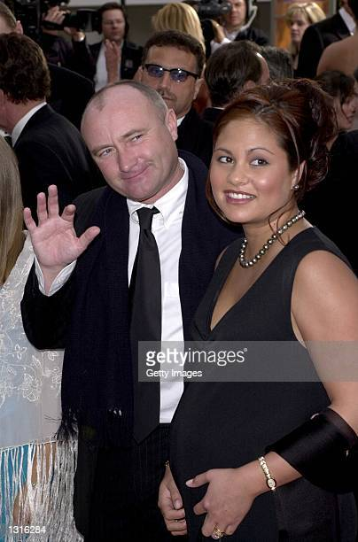 Singer Phil Collins and his wife Orianne who is pregnant arrive at the 58th annual Golden Globes January 21 2001 at the Beverly Hilton Hotel in...