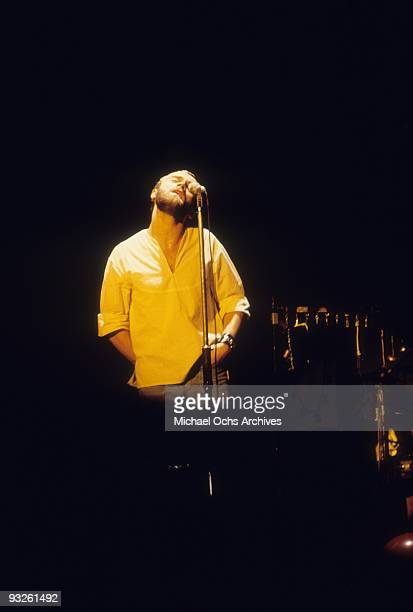 Singer Phil Collins of the progressiverock group Genesis performs onstage after taking over lead singer duties in circa 1977