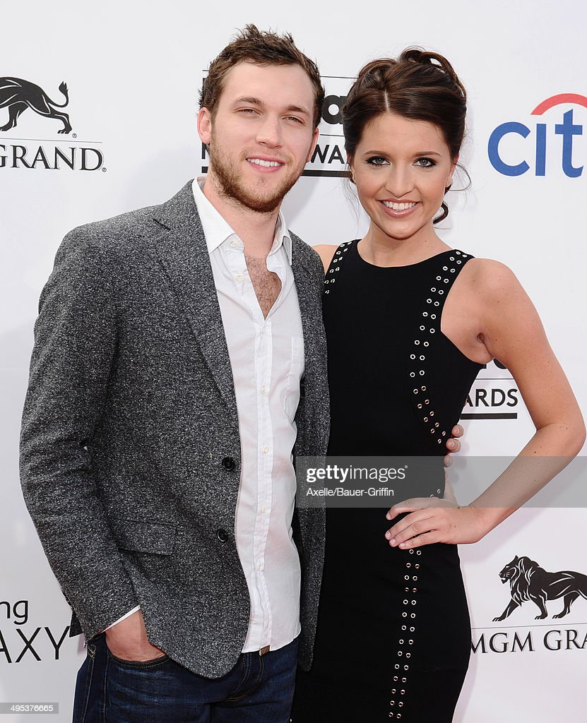Singer Phillip Phillips (L) and Hannah Blackwell arrive at the 2014 Billboard Music Awards at the MGM Grand Garden Arena on May 18, 2014 in Las Vegas, Nevada.