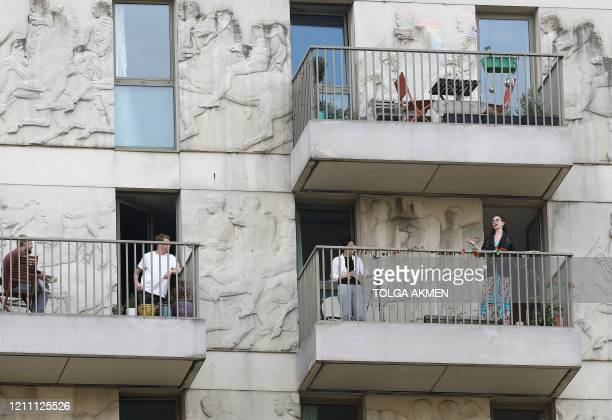 Singer Phoebe Haines performs on her balcony in East Village in Stratford east London on April 27 2020 for her neighbours as British life continues...