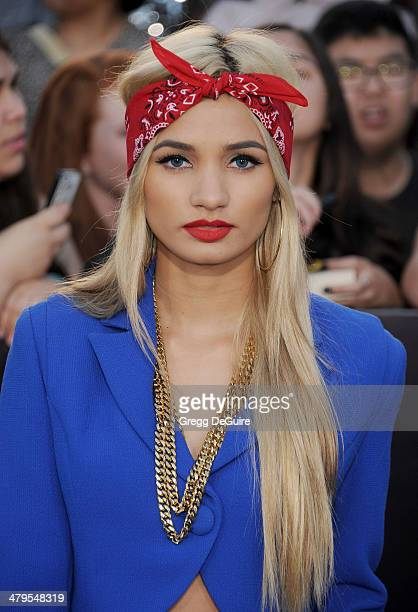Singer Pia Mia arrives at the Los Angeles premiere of 'Divergent' at Regency Bruin Theatre on March 18 2014 in Los Angeles California