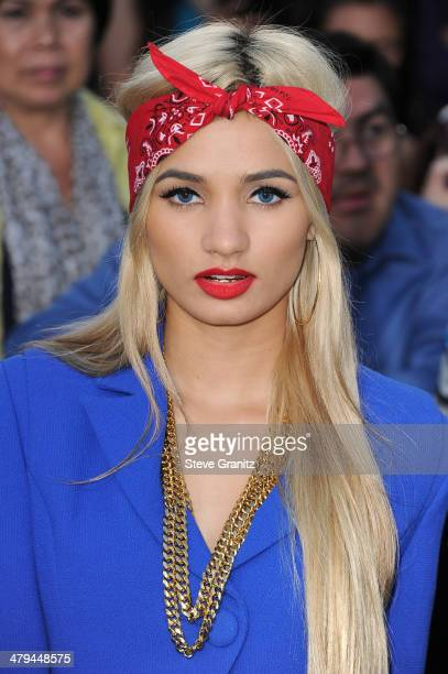 Singer Pia Mia Perez arrives at the premiere of Summit Entertainment's Divergent at the Regency Bruin Theatre on March 18 2014 in Los Angeles...