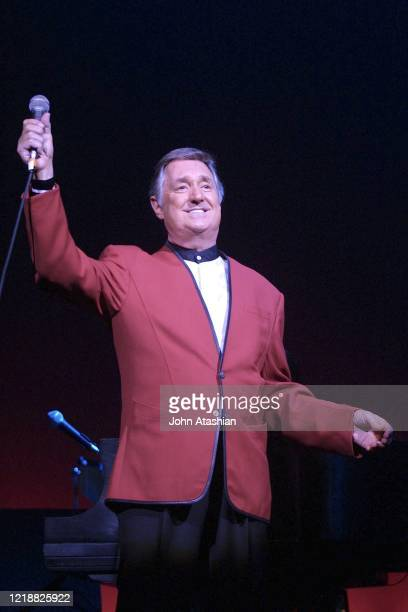 """Singer, pianist, and songwriter Neil Sedaka is shown performing on stage during a """"live"""" concert appearance on July 28, 2002."""