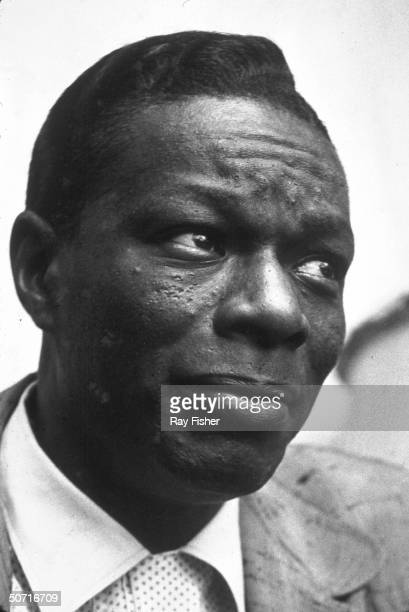 Singer/ pianist Nat King Cole during an interview