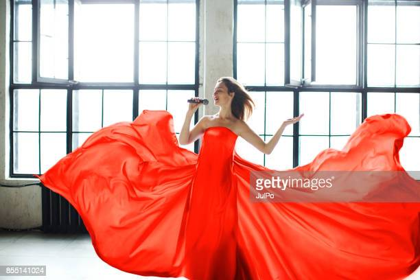 singer - long dress stock pictures, royalty-free photos & images