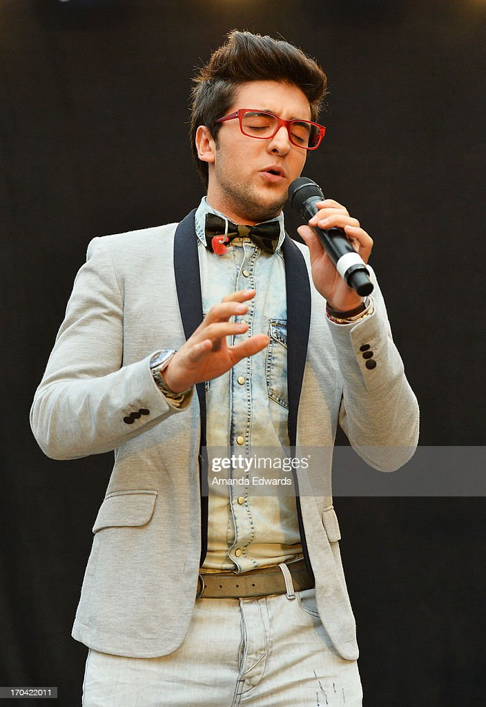 Singer Piero Barone of the group Il Volo performs onstage before signing copies of their new album 'We Are Love' at Santa Monica Place on June 12, 2013 in Santa Monica, California.