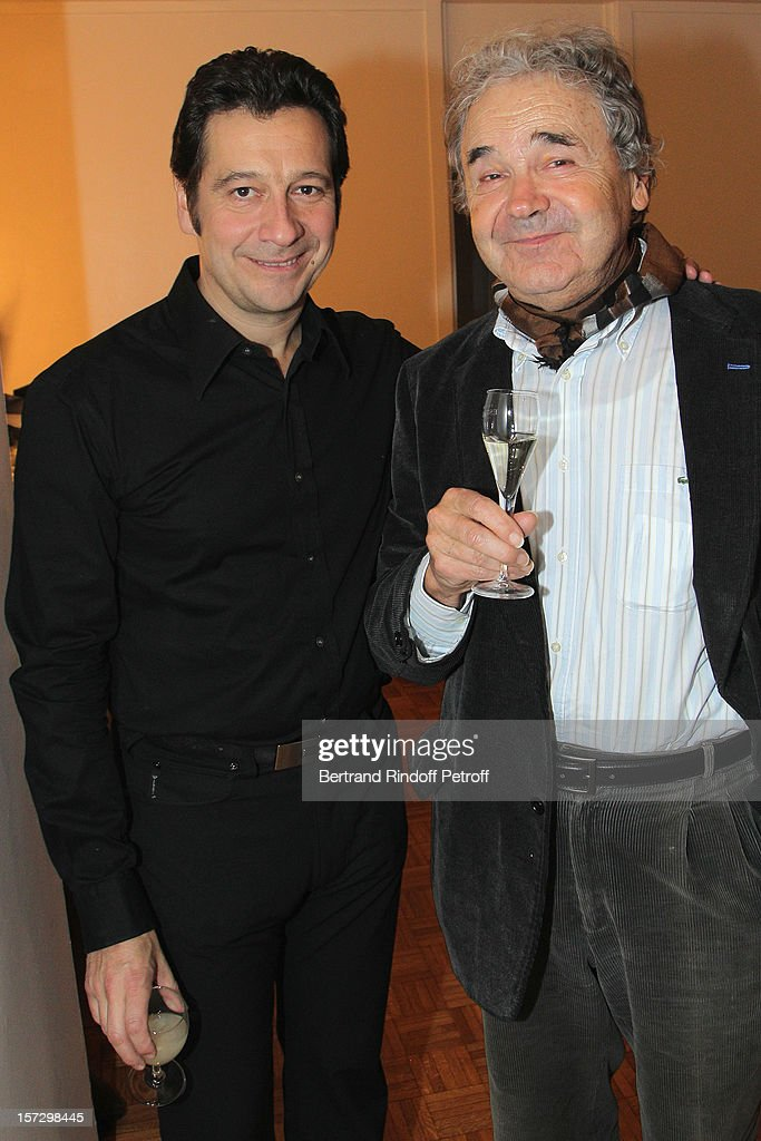 Singer Pierre Perret (R) and French impersonator Laurent Gerra pose in Gerra's dressing room, following his One Man Show at Palais des Congres on November 30, 2012 in Paris, France.