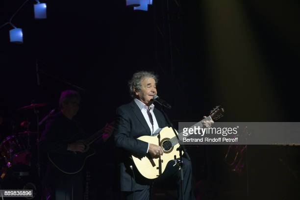 """Singer Pierre Perret performs during the Celebration of """"Pierre Perret 60 Years of Songs"""" at Salle Pleyel on December 10, 2017 in Paris, France."""