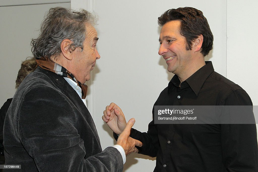 Singer Pierre Perret (L) talks with French impersonator Laurent Gerra, in Gerra's dressing room,following his One Man Show at Palais des Congres on November 30, 2012 in Paris, France.