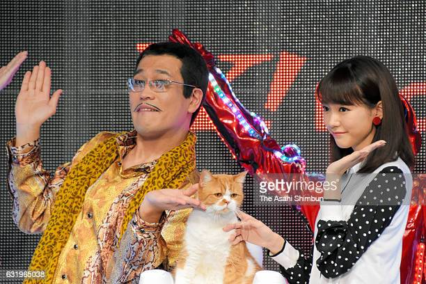Singer Pikotaro actress Mirei Kiritani and cat 'Futenyan' pose during the Y Mobile's Young Discount campaign on January 18 2017 in Tokyo Japan