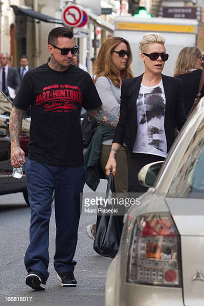 Singer Pink and her husband Carey Hart are seen arriving at the 'Colette' store on April 17 2013 in Paris France