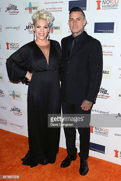 Singer Pink and husband TV personality Carey Hart attend the Share Our Strength's No Kid Hungry Campaign fundraising dinner at Ron Burkle's Green...