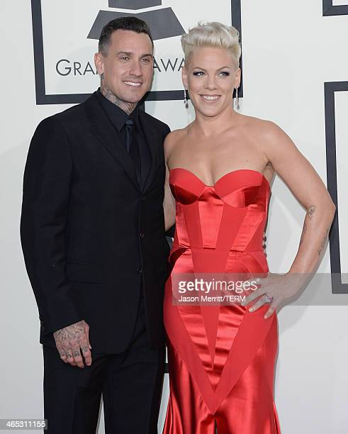 Singer Pink and motorcycle racer Corey Hart attend the 56th GRAMMY Awards at Staples Center on January 26 2014 in Los Angeles California