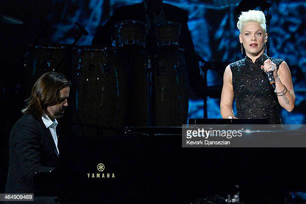 Singer Pink and pianist Paul Mirkovich perform onstage at The 2014 MusiCares Person Of The Year Gala Honoring Carole King at Los Angeles Convention...