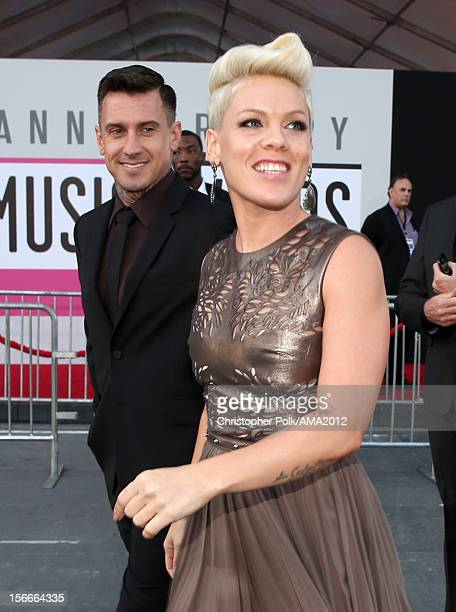 Singer Pink and professional motocross rider Carey Hart attend the 40th American Music Awards held at Nokia Theatre LA Live on November 18 2012 in...