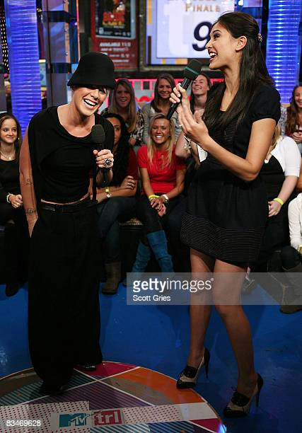 Singer Pink appears onstage with host Lyndsey Rodrigues during MTV's Total Request Live at the MTV Times Square Studios October 28 2008 in New York...