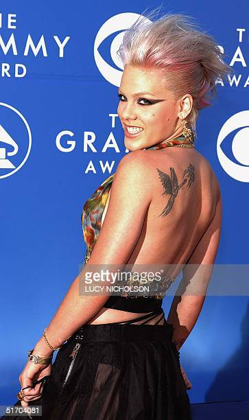 US singer Pink arrives at the 44th Annual Grammy Awards in Los Angeles CA 27 February 2002 Pink Christina Aguilera Lil' Kim and Mya are nominated for...